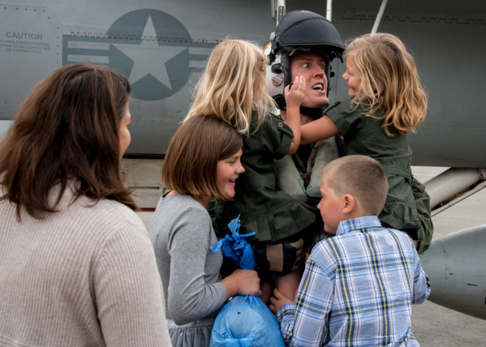 Strike Fighter Squadron (VFA) 27 Commanding Officer Cmdr. Daniel Cochran, from Kent, Wash., is greeted by family members as he returns to Naval Air Facility Atsugi from a patrol embarked aboard the Nimitz-class aircraft carrier USS Ronald Reagan (CVN 76).