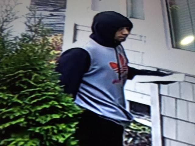 Kent Police are seeking this man for questioning in a Dec. 11 burglary in Kent.