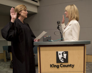 State Senator Patty Kuderer is sworn in by King County Superior Court Presiding Judge Judge Laura Inveen