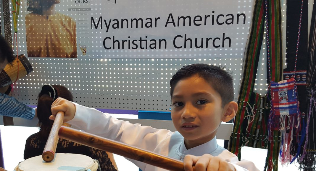 Things To Do in Kent: This charming boy from the Myanmar American Christian Church booth played the drum for me.
