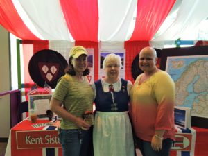 Susan Principe, Florence Amundsen & Dana Ralph checking out the Norway booth during the 2016 Kent International Festival