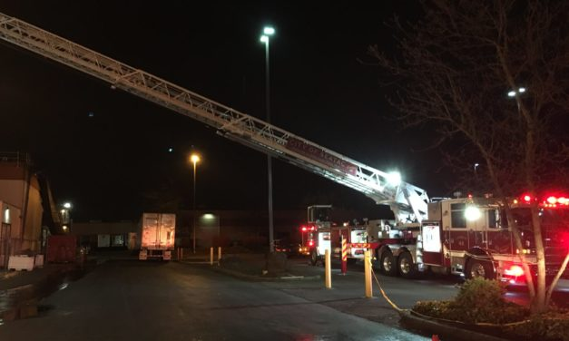 Firefighters Put Out Fire in Commercial Building