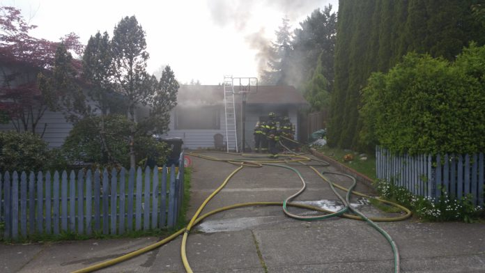 Firefighters respond to a fire in a converted garage on Kent's East Hill Thursday.
