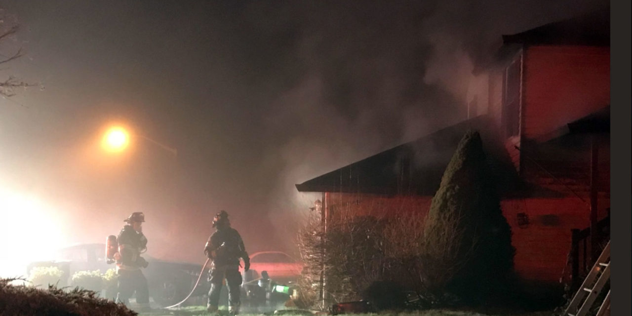Three people, two dogs safe after early morning fire in Kent on New Year's Day