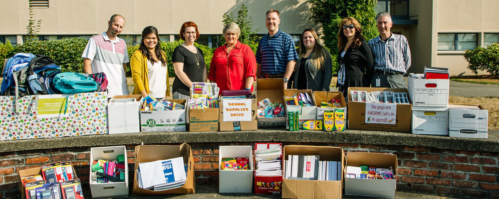 City employees donate school supplies, cash to Kent-Meridian High