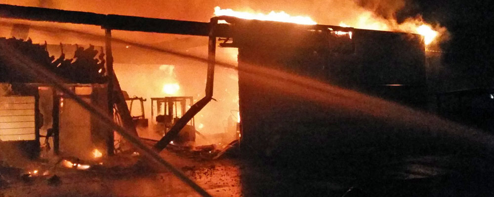 Two-alarm fire hits industrial building in Kent Thursday morning