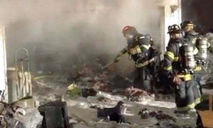 Covington garage fire caused by lit candle