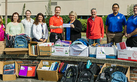 City staff collects back-to-school supplies for Kent-Meridian High School