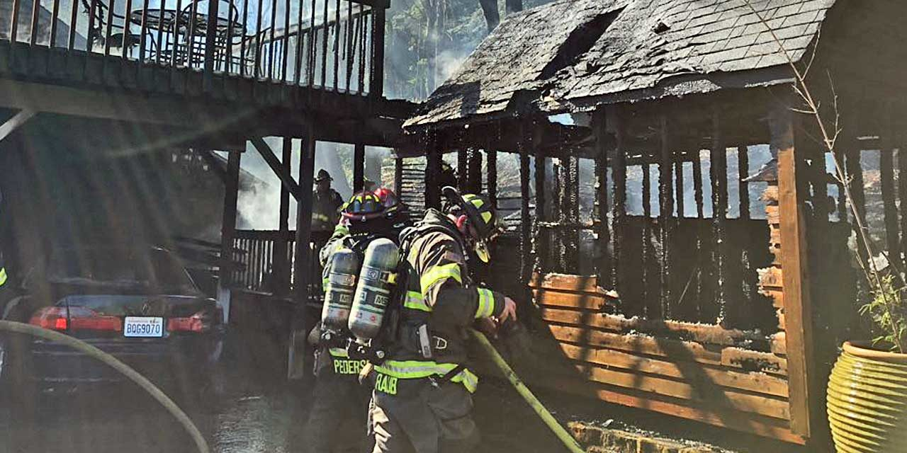 Fire in shed spreads to house in Kent Monday