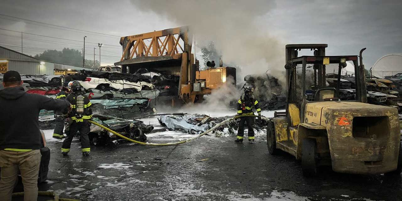 Fire involving 30-40 vehicles in wrecking yard lights up skies in Kent Tuesday morning