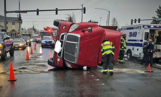 Driver extricated from overturned semi-truck in Kent Tuesday morning