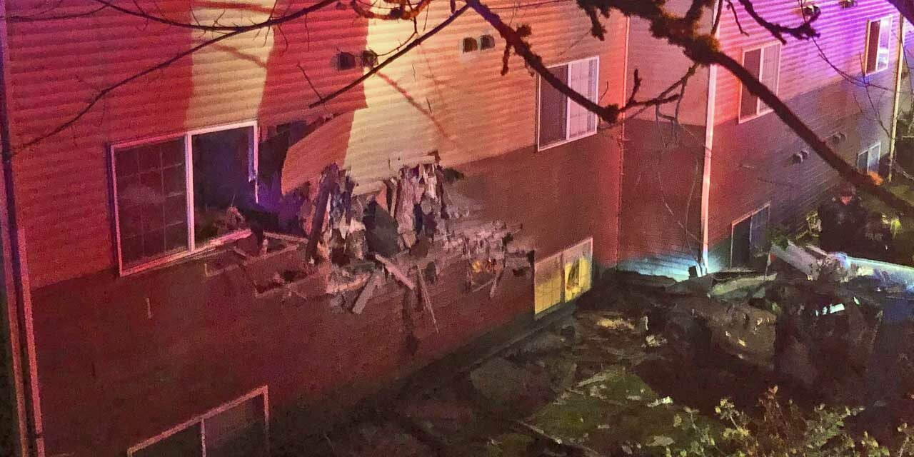 One-car crash into Kent apartment building sends 5 to hospital early Sunday morning